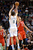 DENVER, CO. - JANUARY 30: Denver Nuggets small forward Danilo Gallinari (8) takes a three point shot over Houston Rockets small forward Chandler Parsons (25) during the fourth quarter January 30, 2013 at Pepsi Center. Danilo Gallinari made the shot and led in scoring with 27 points. The Denver Nuggets take on the Houston Rockets in NBA action. (Photo By John Leyba/The Denver Post)