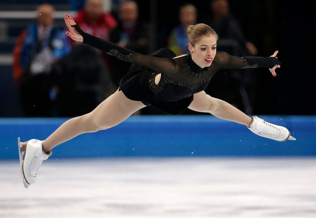 Description of . Carolina Kostner of Italy competes in the women's free skate figure skating finals at the Iceberg Skating Palace during the 2014 Winter Olympics, Thursday, Feb. 20, 2014, in Sochi, Russia. (AP Photo/Bernat Armangue)