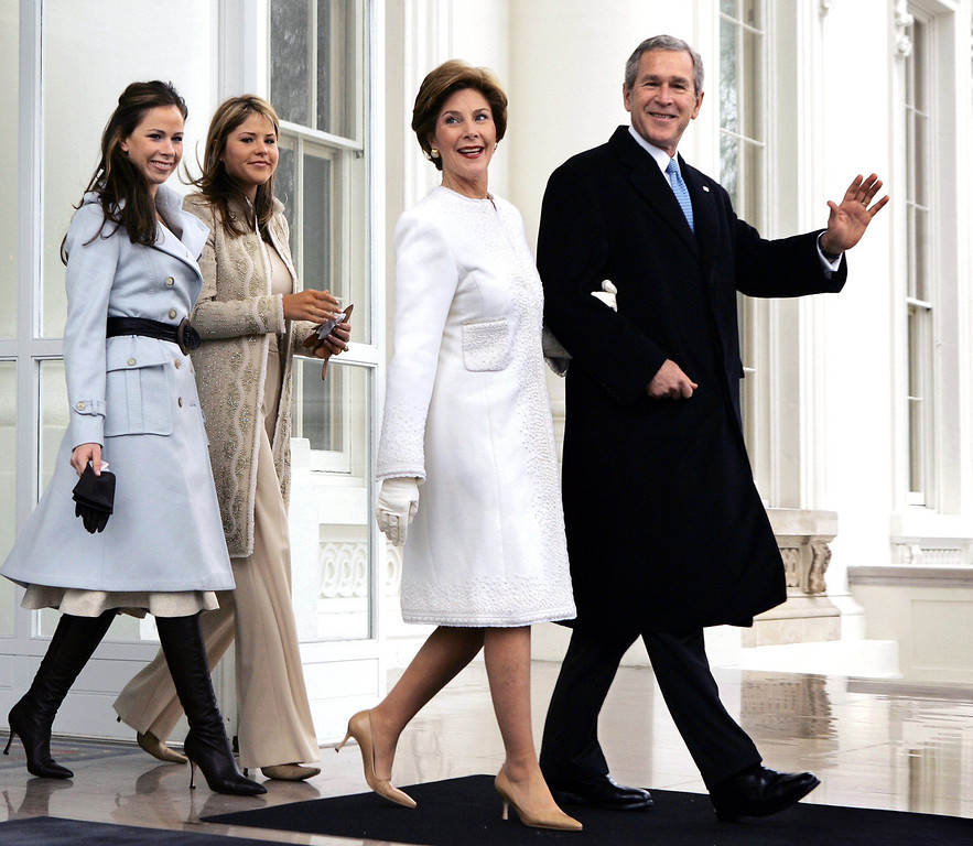 Description of . President George W. Bush and first lady Laura Bush depart the North Portico of the White House for the limousine ride to the Capitol where he will take the Oath of Office and begin his second term, in Washington, Thursday, Jan. 20, 2005. They are joined by their daughters Barbara, far left, and Jenna. (AP Photo/J. Scott Applewhite)