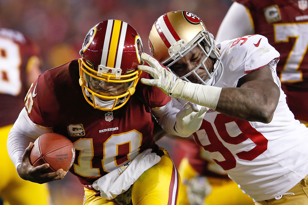 Description of . Washington Redskins quarterback Robert Griffin III is sacked by San Francisco 49ers outside linebacker Aldon Smith during the second half of an NFL football game in Landover, Md., Monday, Nov. 25, 2013. (AP Photo/Evan Vucci)
