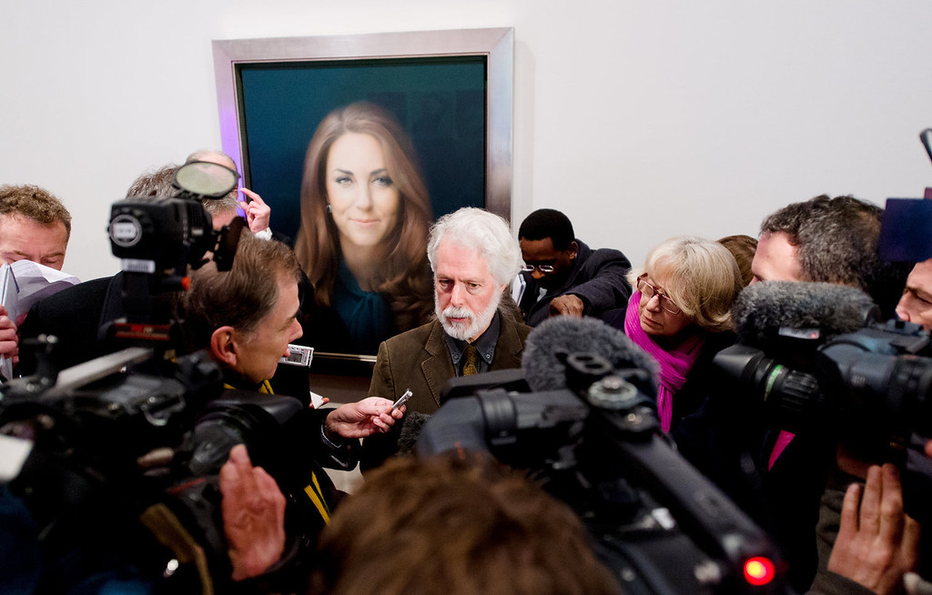 Description of . British artist Paul Emsley poses in front of his portrait of Catherine, The Duchess of Cambridge after its unveiling at the National Portrait Gallery in central London on January 11, 2013. This is the first official portrait of the Duchess and was completed after two sittings at the artist\'s studio and Kensington Palace.  LEON NEAL/AFP/Getty Images)
