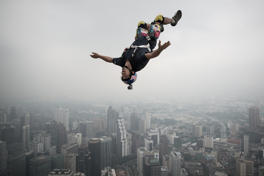 Description of . Base jumper Vincent Philippe Benjamin Reffet from France leaps from the 300-metres Open Deck of the Malaysia's landmark Kuala Lumpur Tower during the International Tower Jump in Kuala Lumpur on September 27, 2013. Some 103 professional base jumpers from 20 countries are taking part in the annual event.    AFP PHOTO / MOHD RASFAN/AFP/Getty Images