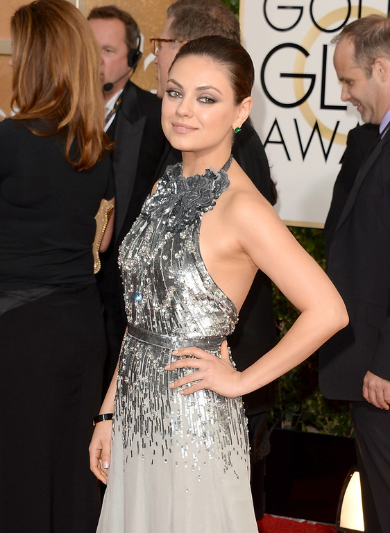 Description of . Actress Mila Kunis attends the 71st Annual Golden Globe Awards held at The Beverly Hilton Hotel on January 12, 2014 in Beverly Hills, California.  (Photo by Jason Merritt/Getty Images)