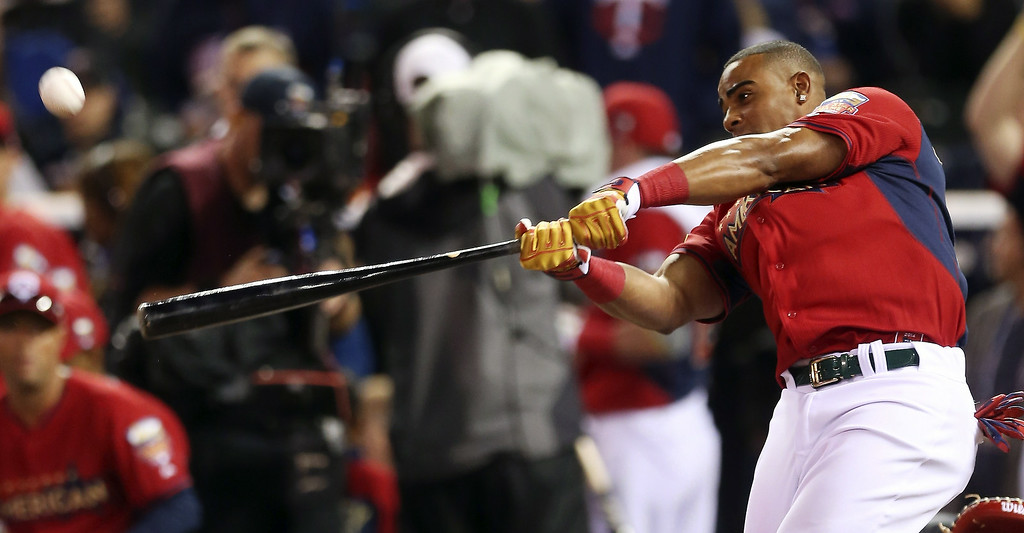 Description of . American League's Yoenis Cespedes, of the Oakland Athletics, hits during the MLB All-Star baseball Home Run Derby, Monday, July 14, 2014, in Minneapolis. (AP Photo/Jim Mone)