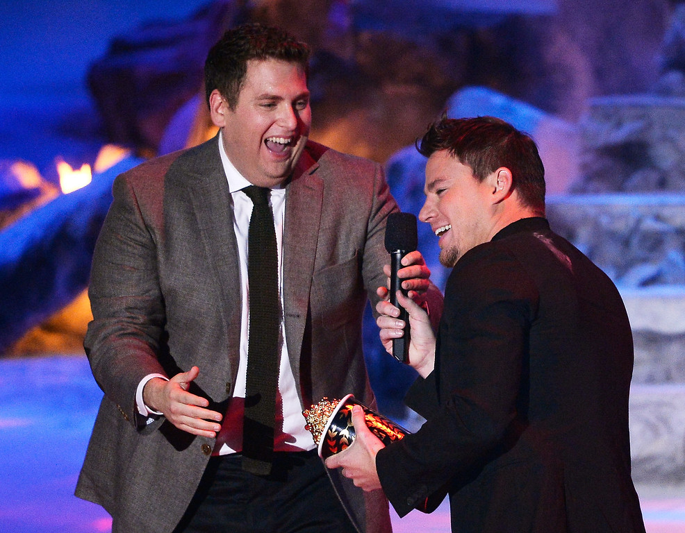 Description of . Actor Jonah Hill (L) presents the Trailblazer Award to honoree Channing Tatum onstage at the 2014 MTV Movie Awards at Nokia Theatre L.A. Live on April 13, 2014 in Los Angeles, California.  (Photo by Kevork Djansezian/Getty Images for MTV)