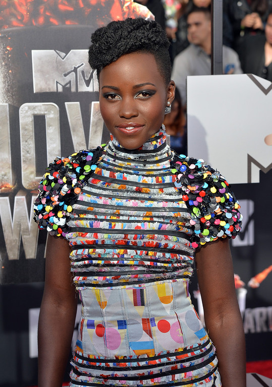 Description of . Actress Lupita Nyong'o attends the 2014 MTV Movie Awards at Nokia Theatre L.A. Live on April 13, 2014 in Los Angeles, California.  (Photo by Michael Buckner/Getty Images)