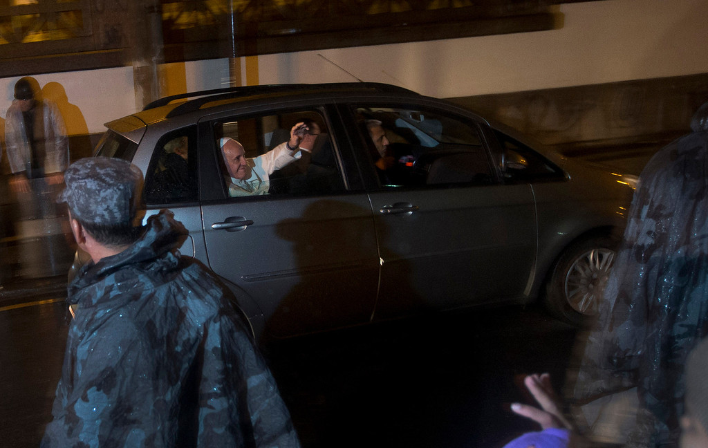 Description of . Pope Francis waves as he arrives to the St. Francis of Assisi of the Providence of God Hospital, where the Franciscans look after alcohol and drug addicts, in Rio de Janeiro, Brazil, Wednesday, July 24, 2013. Francis made an emotional plea Wednesday for Roman Catholics to shun materialism in the first public Mass of his initial international trip as pontiff, then met with drug addicts in Rio and denounced the