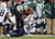 Wide receiver Chaz Schilens #85 of the New York Jets is tackled by Quentin Jammer #23 of the San Diego Chargers during the second half at MetLife Stadium on December 23, 2012 in East Rutherford, New Jersey. The Chargers defeated the Jets 27-17. (Photo by Rich Schultz /Getty Images)
