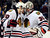 Chicago Blackhawks goalie Ray Emery (30) celebrates a 5-2 victory over the Colorado Avalanche with Brandon Saad (20) during the third period of an NHL hockey game, Monday, March 18, 2013, in Denver. (AP Photo/Jack Dempsey)
