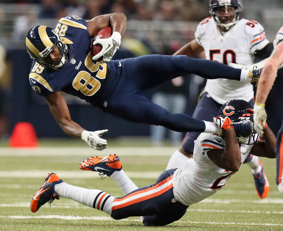 Description of . St. Louis Rams tight end Jared Cook (89) is tackled by Chicago Bears safety Major Wright in the fourth quarter of an NFL football game on Sunday, Nov. 24, 2013, in St. Louis. (AP Photo/St. Louis Post-Dispatch, Chris Lee)
