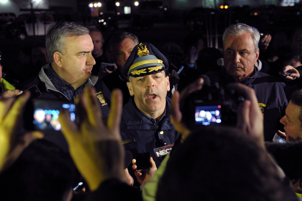 Description of . Colonel Timothy Albens (C), of the Massachusetts State Police, Boston Police Commissioner Ed Davis (L) and Watertown Chief of Police Edward P. Deveau (R) speak to the media as a search for the second of the two suspects wanted in the Boston Marathon bombings takes place on April 19, 2013 in Watertown, Massachusetts. (STAN HONDA/AFP/Getty Images)