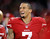 San Francisco 49ers quarterback Colin Kaepernick (7) smiles on the sideline during the fourth quarter of an NFC divisional playoff NFL football game against the Green Bay Packers in San Francisco, Saturday, Jan. 12, 2013. The 49ers won 45-31. (AP Photo/Tony Avelar)