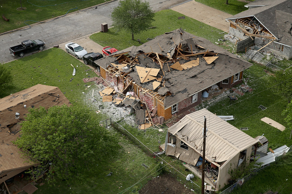 Description of . WEST, TX - APRIL 18:  One of the numerous homes damaged by an explosion yesterday at the West Fertilizer Company is shown from the air on April 18, 2013 in West, Texas. According to West Mayor Tommy Muska, around 14 people, including 10 first responders, were killed and more than 150 people were injured when the fertilizer company caught fire and exploded, leaving damaged buildings for blocks in every direction.  (Photo by Chip Somodevilla/Getty Images)
