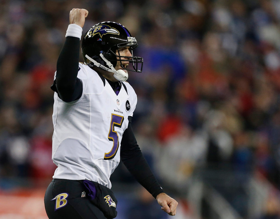 Description of . Baltimore Ravens quarterback Joe Flacco celebrates after an 11-yard touchdown pass to Anquan Boldin during the second half of the NFL football AFC Championship football game against the New England Patriots in Foxborough, Mass., Sunday, Jan. 20, 2013. (AP Photo/Charles Krupa)
