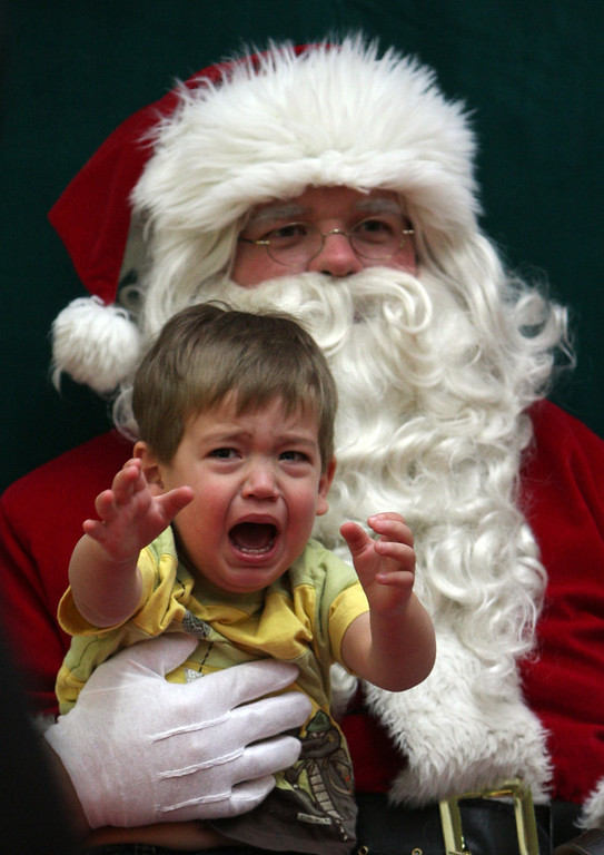 Description of . Eighteen-month-old Riley Flannery screams for his mother while sitting on Santa's knee at the Shoppers Mall in Brandon, Man., Canada on Saturday, Dec. 20, 2008. (AP Photo/Brandon Sun-Tim Smith via the Canadian Press, Tim Smith)