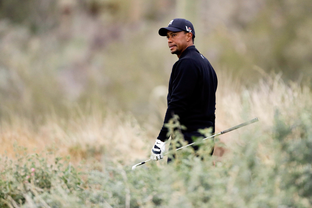 Description of . Tiger Woods looks down from the 12th tee box at his lie on the fairway in the first round against Charles Howell III during the Match Play Championship golf tournament, Thursday, Feb. 21, 2013, in Marana, Ariz. (AP Photo/Ted S. Warren)