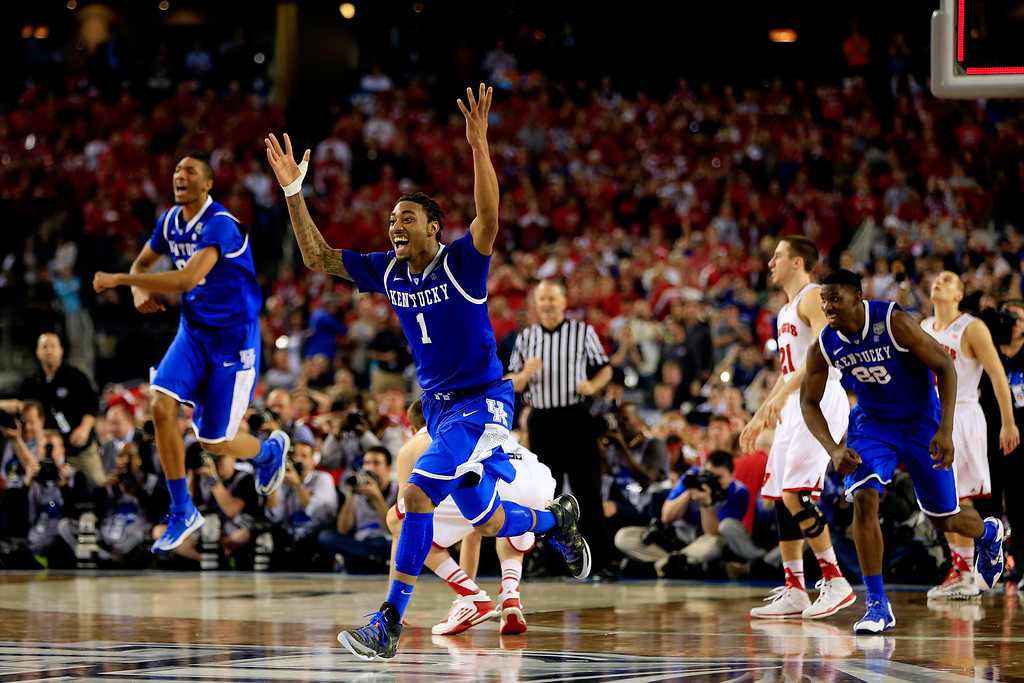 Description of . ARLINGTON, TX - APRIL 05: James Young #1 of the Kentucky Wildcats reacts after defeating the Wisconsin Badgers 74-73 in the NCAA Men's Final Four Semifinal at AT&T Stadium on April 5, 2014 in Arlington, Texas.  (Photo by Jamie Squire/Getty Images)