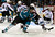 James Sheppard #15 of the San Jose Sharks gets an assist passing the puck by Greg Zanon #4 of the Colorado Avalanche to teammate TJ Galiardi #21 who scored on the play in the second period at HP Pavilion on February 26, 2013 in San Jose, California.  (Photo by Thearon W. Henderson/Getty Images)