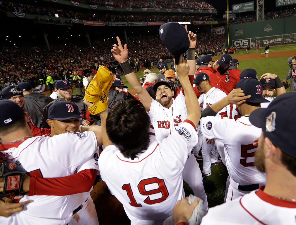 Description of . The Boston Red Sox celebrate after defeating the St. Louis Cardinals in Game 6 of baseball's World Series Wednesday, Oct. 30, 2013, in Boston. The Red Sox won 6-1 to win the series. (AP Photo/David J. Phillip)
