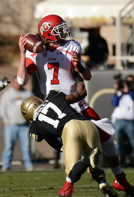 Description of . University of Colorado Marques Mosley, bottom, pressures Utah quarterback Travis Wilson in the second quarter at Folsom Field on Friday, November 23, 2012. Utah won 42-35. Hyoung Chang, The Denver Post
