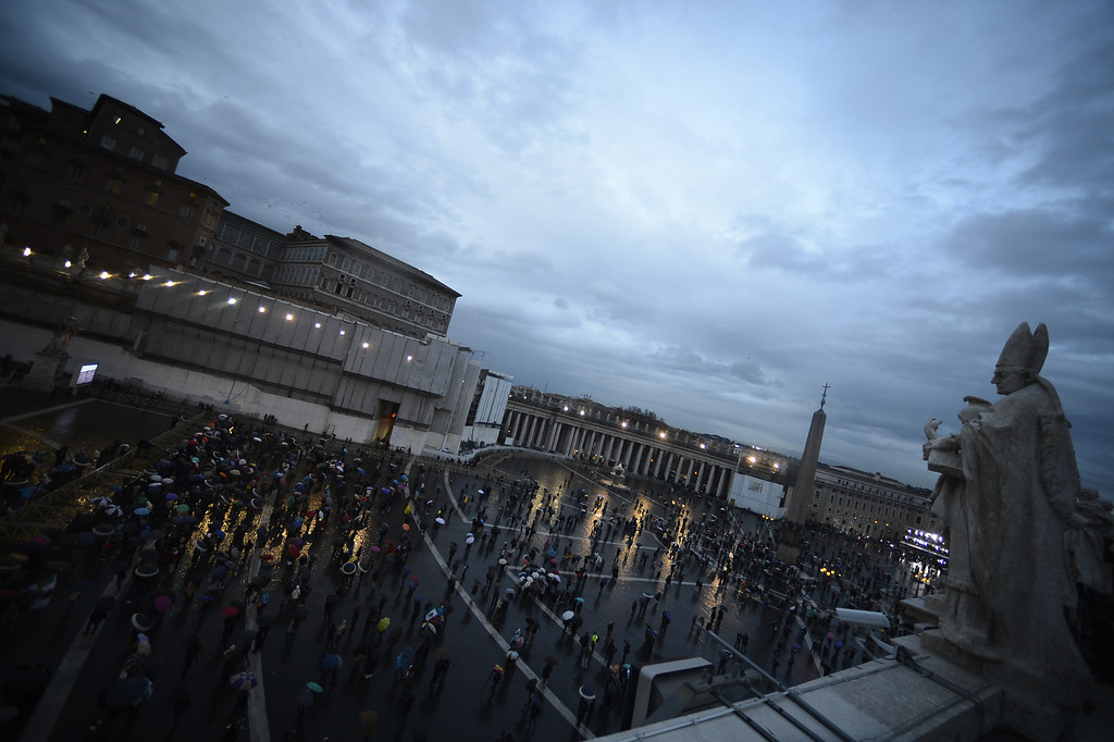 Description of . People wait on St Peter\'s square during the conclave on March 12, 2013 at the Vatican. AFP PHOTO / FILIPPO MONTEFORTE/AFP/Getty Images