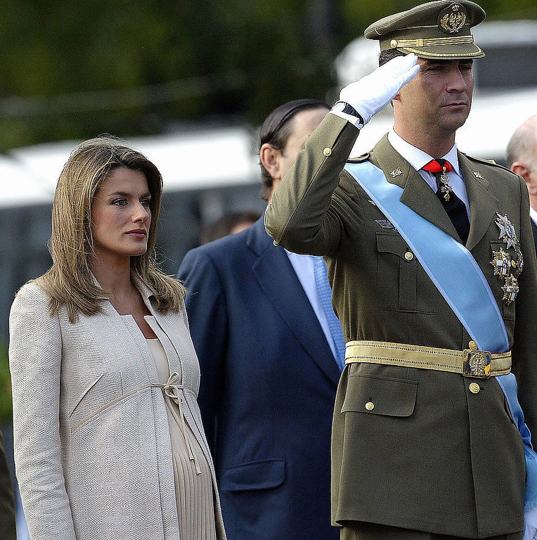 Description of . Spain's Prince Felipe (R) salutes next to his wife Princess Letizia as they watch the national day army parade in Madrid. Princess Letizia, the eight-and-a-half-months pregnant wife of Spanish heir to the throne Prince Felipe de Bourbon, was admitted to a private maternity clinic 30 October 2005 on medical advice, the royal palace announced. JAVIER SORIANO/AFP/Getty Images