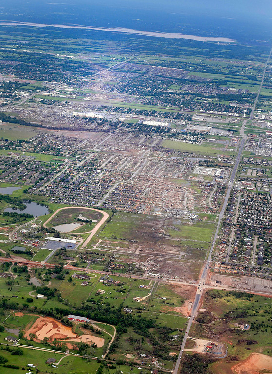 Description of . This Tuesday, May 21, 2013 aerial photo shows, from foreground to background, the path Monday's deadly tornado took through Moore, Okla. (AP Photo/Kim Johnson Flodin)