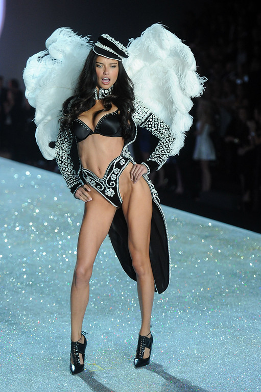 Description of . Model Adriana Lima walks the runway at the 2013 Victoria's Secret Fashion Show at Lexington Avenue Armory on November 13, 2013 in New York City.  (Photo by Jamie McCarthy/Getty Images)