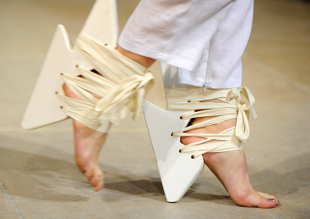Description of . A model presents shoes for Fatima Lopes' ready-to-wear Spring/Summer 2014 fashion collection presented in Paris, Tuesday, Oct.1, 2013. (AP Photo/Zacharie Scheurer)