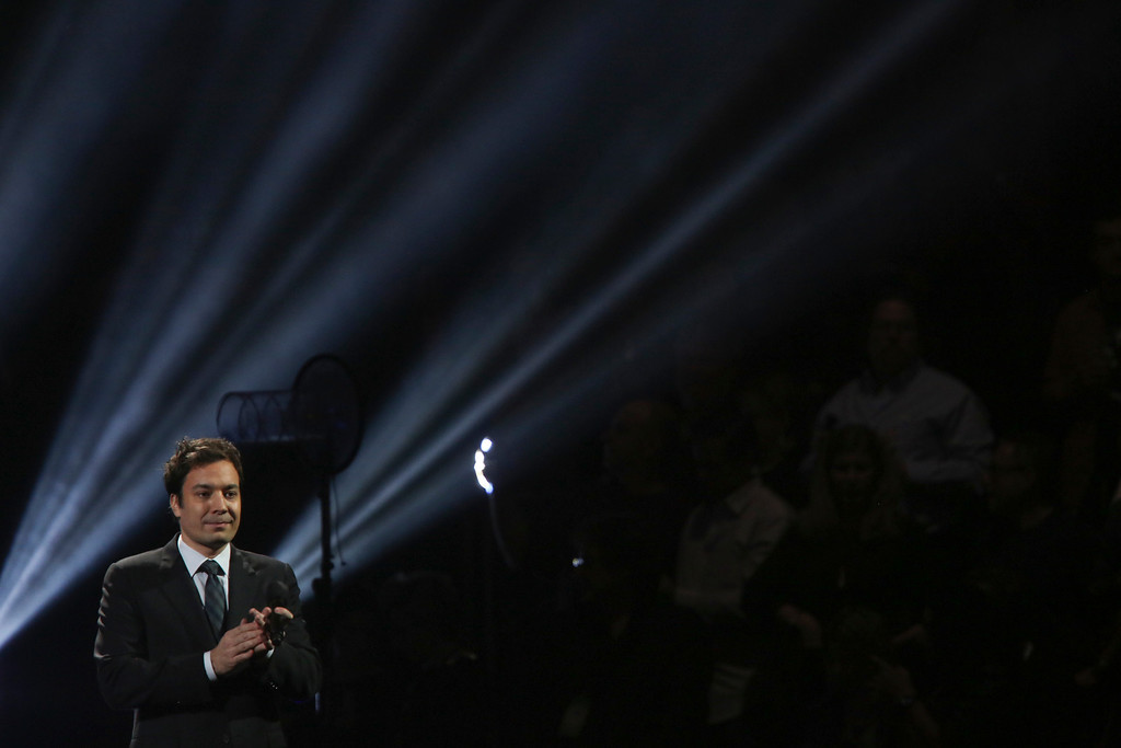 Description of . The actor Jimmy Fallon speaks at the 12-12-12 benefit concert for victims of Hurricane Sandy, at Madison Square Garden in New York, Dec. 12, 2012. The concert features a lineup of artists spanning five decades. (Damon Winter/The New York Times)