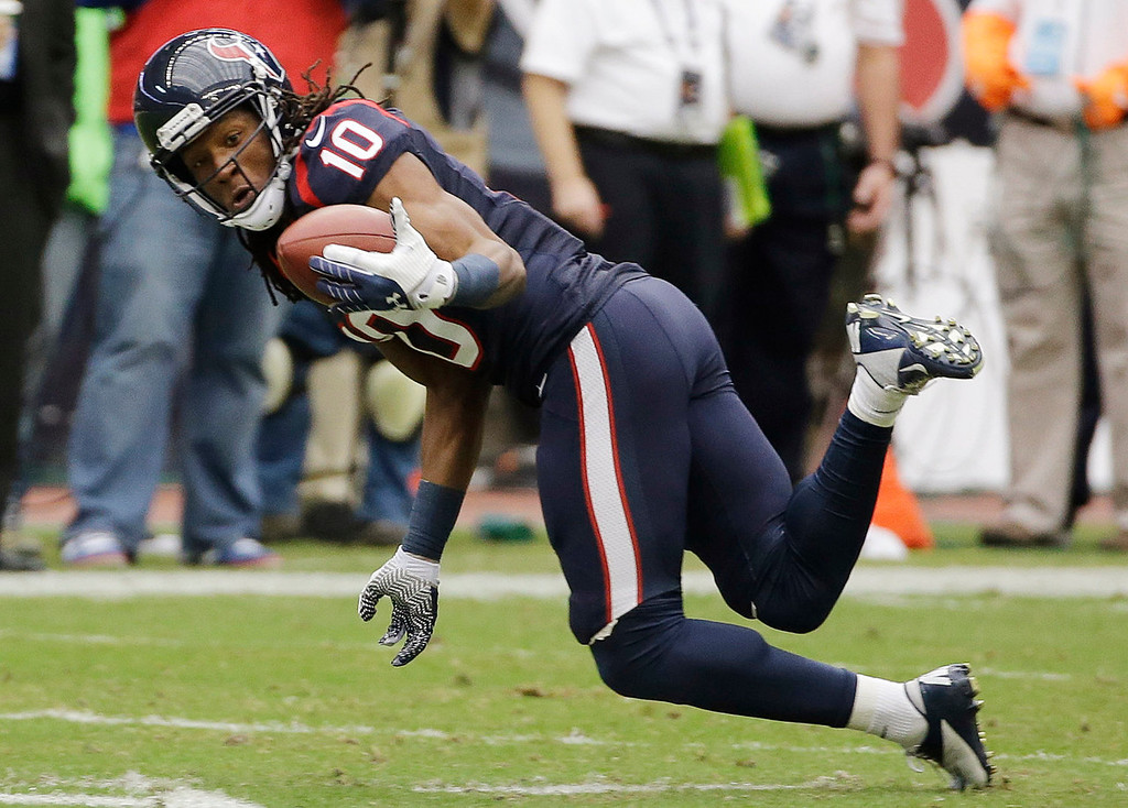 Description of . Houston Texans wide receiver DeAndre Hopkins (10) makes a catch during the first quarter an NFL football game against the Jacksonville Jaguars Sunday, Nov. 24, 2013, in Houston. (AP Photo/David J. Phillip)