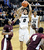 University of Colorado's Askia Booker takes a shot over Madarious Gibbs, left, and Fred Sturdivant, right, during a game against Texas Southern on Tuesday, Nov. 27, at the Coors Event Center on the CU campus in Boulder.    Jeremy Papasso/ Camera