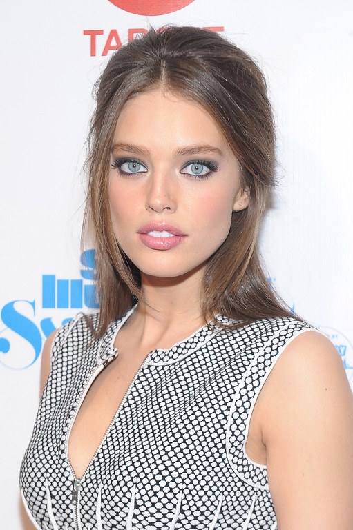 Description of . NEW YORK, NY - FEBRUARY 12:  Model Emily DiDonato attends as Sports Illustrated celebrates SI Swimsuit 2013 with a star-studded red carpet kickoff event at Crimson on February 12, 2013 in New York City.  (Photo by Michael Loccisano/Getty Images for Sports Illustrated)