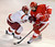Cornell centr Dustin Mowrey (20) tried to skate past Denver defenseman Paul Phillips (7) in the second period. The University of Denver hockey team hosted Cornell at Magness Arena Saturday night, January 5, 2013. Karl Gehring/The Denver Post