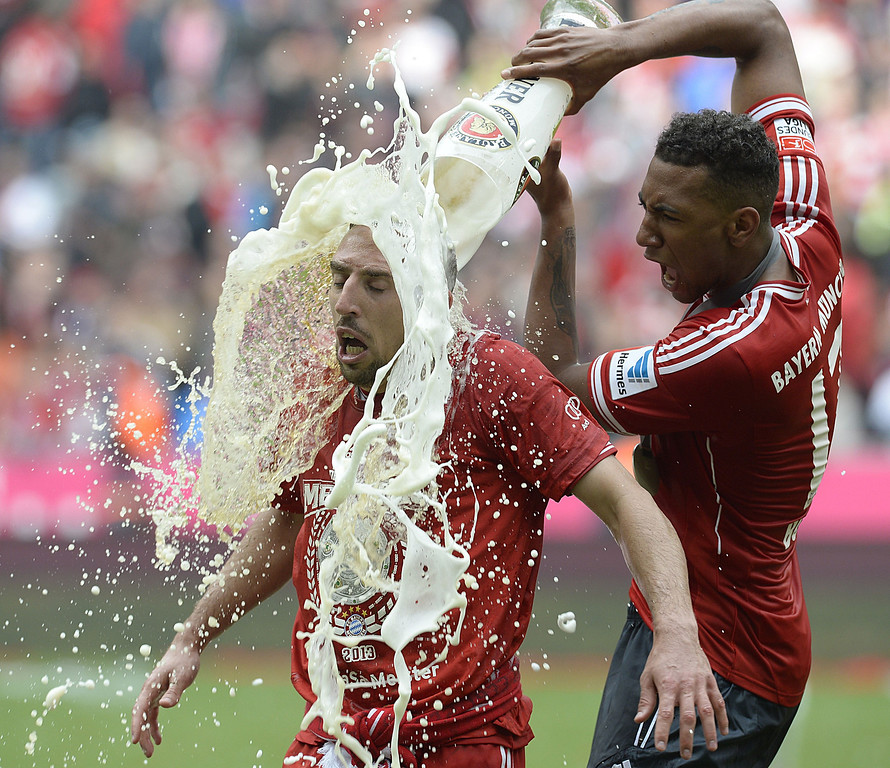 Description of . Bayern Munich's defender Jerome Boateng (R) pours beer on Bayern Munich's French midfielder Franck Ribery while celebrating their champion title, after winning 3:0 the German first division Bundesliga soccer match between Bayern Munich and FC Augsburg in Munich, southern Germany, on May 11, 2013.   CHRISTOF STACHE/AFP/Getty Images
