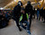 An Iberia worker is removed by Spanish riot police officers during clashes at Terminal 4 of Madrid's Barajas airport February 18, 2013. Workers at loss-making Spanish flag carrier Iberia began a five-day strike at midnight on Monday, grounding over 1,000 flights and costing the airline and struggling national economy millions of euros. REUTERS/Sergio Perez