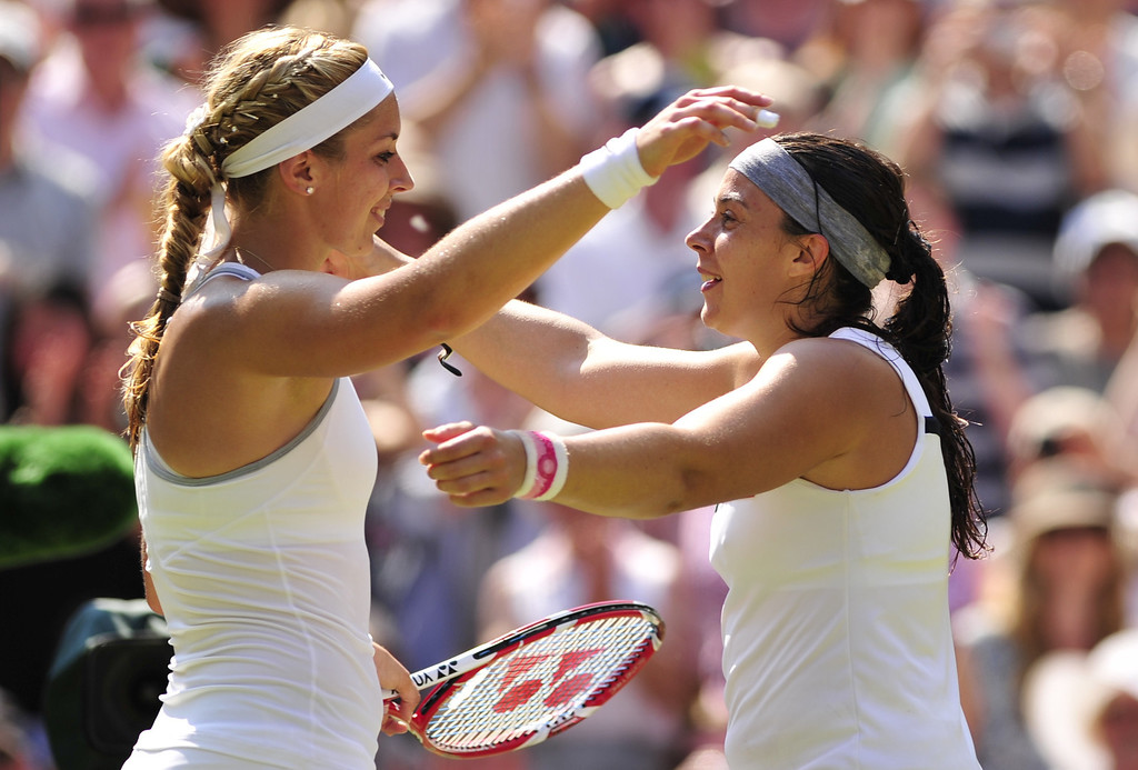 Description of . France's Marion Bartoli (R) embraces runner up Germany's Sabine Lisicki (L) following Barolti's victory in their women's singles final match on day twelve of the 2013 Wimbledon Championships tennis tournament at the All England Club in Wimbledon, southwest London, on July 6, 2013. Bartoli won 6-1, 6-4.  GLYN KIRK/AFP/Getty Images