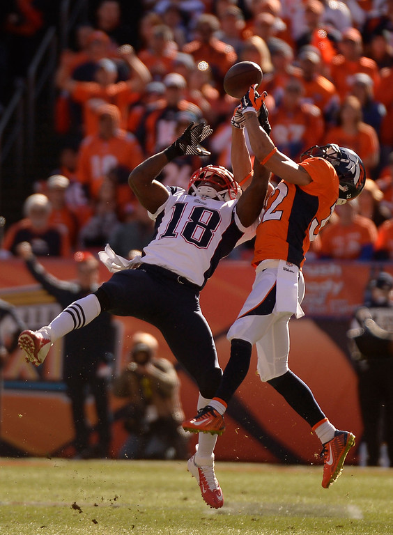 Description of . Denver Broncos cornerback Tony Carter (32) breaks up a pass intended for New England Patriots wide receiver Matthew Slater (18) during the first quarter. The Denver Broncos vs. The New England Patriots in an AFC Championship game  at Sports Authority Field at Mile High in Denver on January 19, 2014. (Photo by John Leyba/The Denver Post)