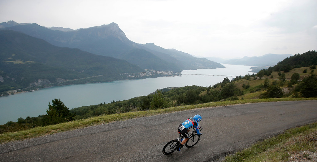 Description of . Daniel Martin of Ireland passes Serre-Poncon lake during the seventeenth stage of the Tour de France cycling race an individual time trial over 32 kilometers (20 miles) with start in Embrun and finish in Chorges, France, Wednesday July 17, 2013. (AP Photo/Laurent Cipriani)