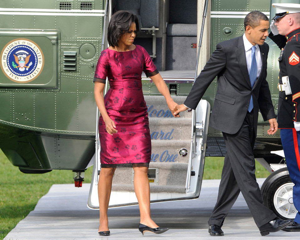 Description of . This April 3, 2009 file photo shows President Barack Obama, and first lady Michelle Obama, left, disembark from a helicopter at the Klosterwiese in Baden-Baden, Germany. (AP Photo/Christof Stache,File)