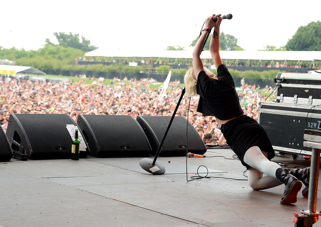 Description of . CHICAGO, IL - AUGUST 02:  Alice Glass of Crystal Castles performs during Lollapalooza 2013 at Grant Park on August 2, 2013 in Chicago, Illinois.  (Photo by Theo Wargo/Getty Images)