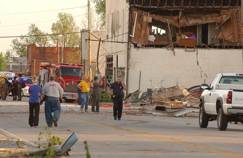 Description of . First responders, volunteers and firemen gather on Main Street in Quapaw, Okla. after a tornado struck the city on Sunday evening, April 27, 2014.    A powerful storm system rumbled through the central and southern United States on Sunday, spawning a massive tornado that carved path of destruction through the northern Little Rock suburbs and another twister that killed two people in Oklahoma and injured others in Kansas. (AP Photo/Tulsa World,  Gary Crow)