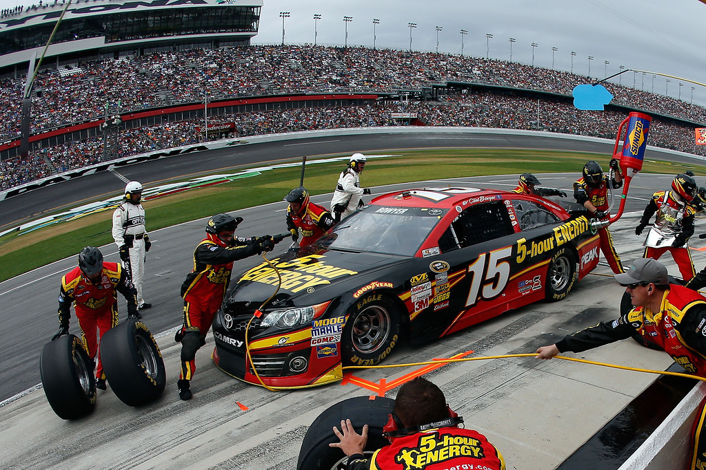 Description of . Clint Bowyer, driver of the #15 5-hour ENERGY Toyota, pits during the NASCAR Sprint Cup Series Daytona 500 at Daytona International Speedway on February 24, 2013 in Daytona Beach, Florida.  (Photo by Chris Graythen/Getty Images)