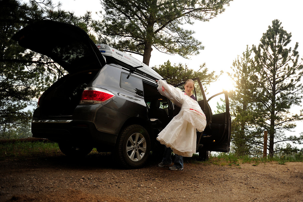 Description of . Rebecca DeMott packs her wedding dress as her parents' home in Glacier View Meadows was under pre-evacuation notice as the High Park fire burns on Stove Prairie Road and Highway 14 in Poudre Canyon west of Fort Collins on Tuesday, June 12, 2012. The fire has now burned more than 40,000 acres encompassing more than 65 square miles. AAron Ontiveroz, The Denver Post