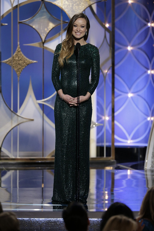 Description of . In this handout photo provided by NBCUniversal, Presenter Olivia Wilde speaks onstage during the 71st Annual Golden Globe Award at The Beverly Hilton Hotel on January 12, 2014 in Beverly Hills, California.  (Photo by Paul Drinkwater/NBCUniversal via Getty Images)