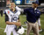 Navy quarterback Keenan Reynolds (19) is congratulated by Navy coach Ivan Jasper on a win over Army at the conclusion of the Army versus Navy NCAA football game in Philadelphia, Pennsylvania, December 8, 2012. REUTERS/Tim Shaffer