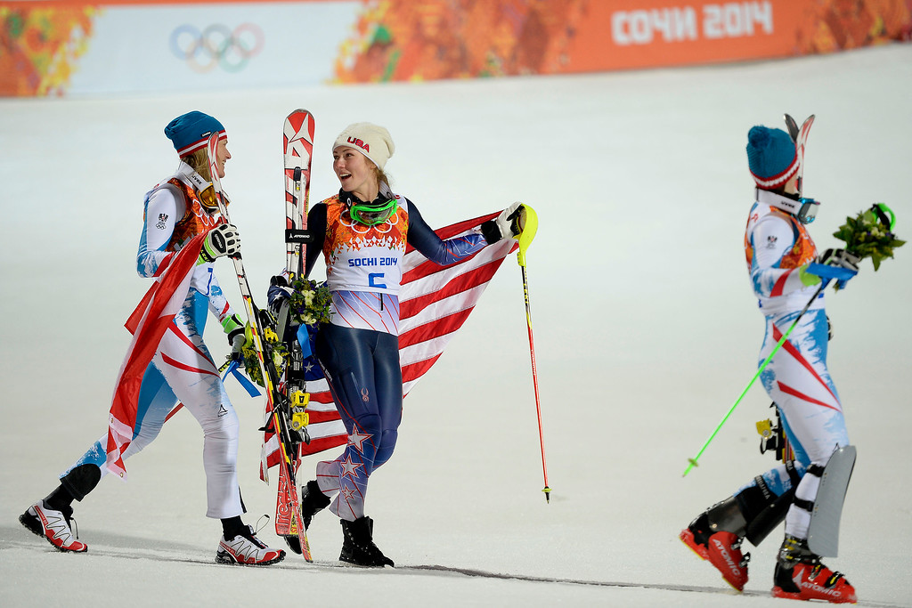 Description of . Gold medalist American Mikaela Shiffrin (center) jokes with silver medalist Marlies Schild of Austria (left) as they walk to the podium with bronze medalist Kathrin Zettel of Austria after ladies' slalom run 2. Sochi 2014 Winter Olympics on Friday, February 21, 2014 at Rosa Khutor Alpine Center. (Photo by AAron Ontiveroz/ The Denver Post)