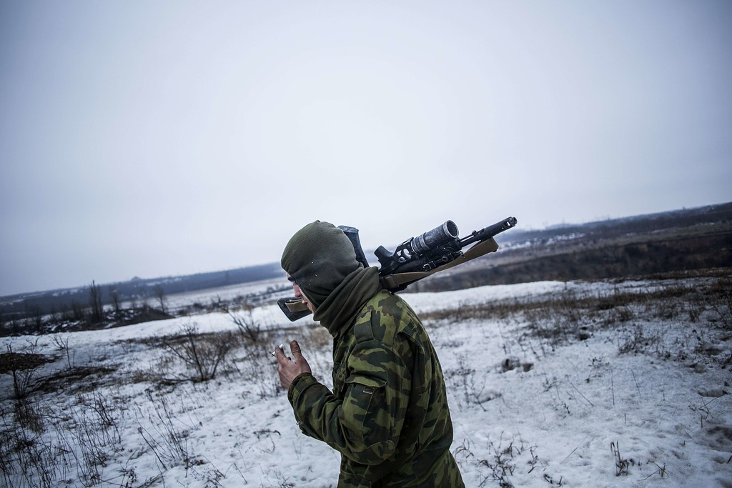 Description of . A pro-Russian separatist walks to his position in the vicinity of the eastern Ukrainian city of Debaltseve, in the Donetsk region, on January 28, 2015. Ukraine President Petro Poroshenko made a personal plea to Russia's Vladimir Putin and Washington threatened tougher measures should Moscow fail to rein in separatists mounting a new offensive in the east of the ex-Soviet republic. MANU BRABO/AFP/Getty Images