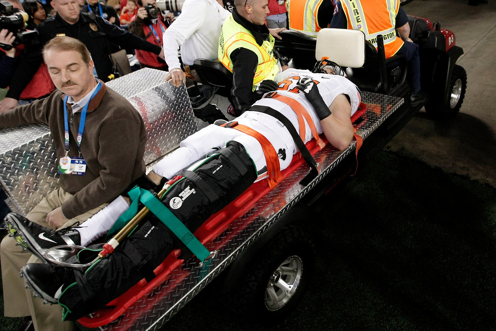 Description of . Oklahoma State offensive linesman Brandon Garrett (67) is taken from the field after being injured against Missouri during the first half of the Cotton Bowl NCAA college football game on Friday, Jan. 3, 2014, in Arlington, Texas. (AP Photo/Brandon Wade)