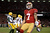 Quarterback Colin Kaepernick #7 of the San Francisco 49ers celebrates after running in a touchdown in the first quarter against the Green Bay Packers during the NFC Divisional Playoff Game at Candlestick Park on January 12, 2013 in San Francisco, California.  (Photo by Harry How/Getty Images)